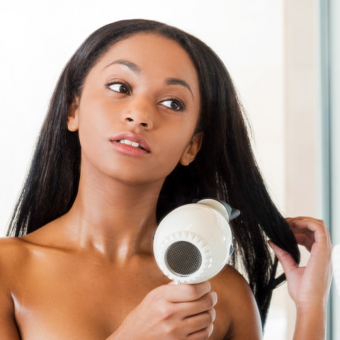 Woman benefiting from healthy Hair and Skin with a home water softener system