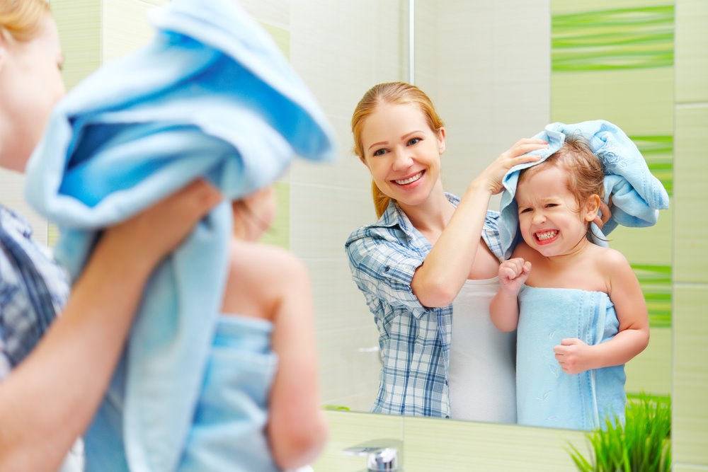 Mother provides healthier skin and hair for her child with water softener system