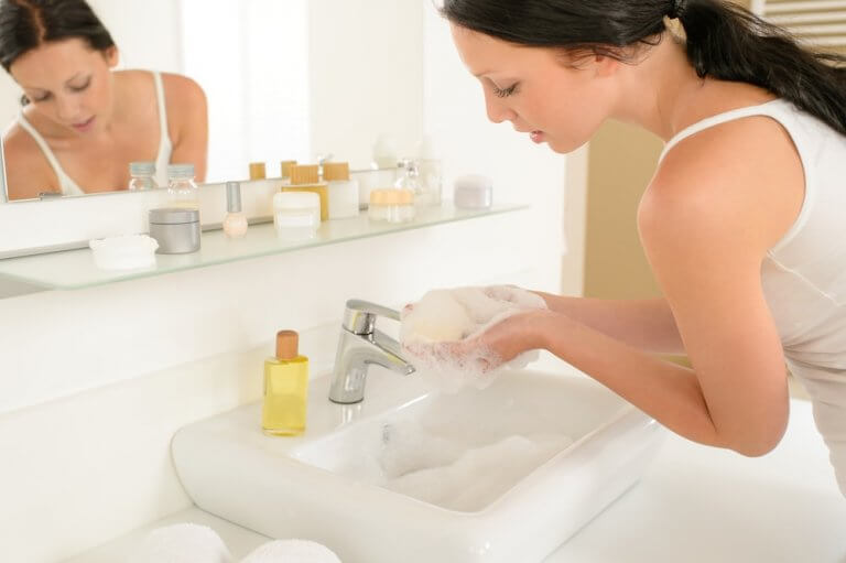 Woman maintains healthier skin with home water softener system