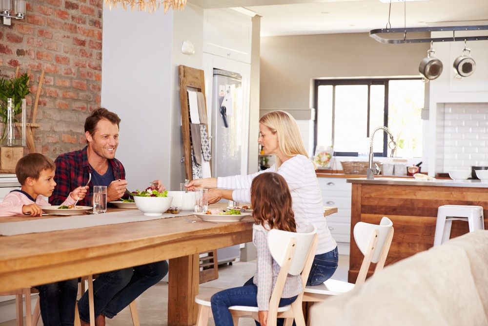 Family enjoying healthier dinner and water from Home Water Softener system