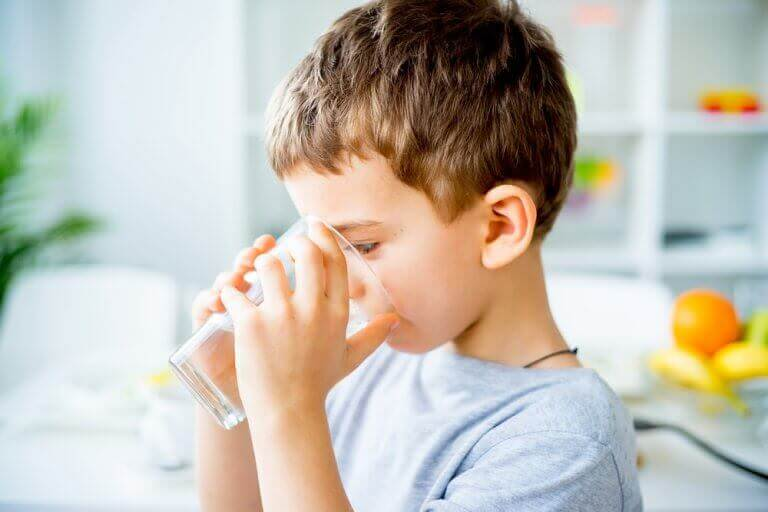 Child enjoys healthier water from a whole house water filtration system