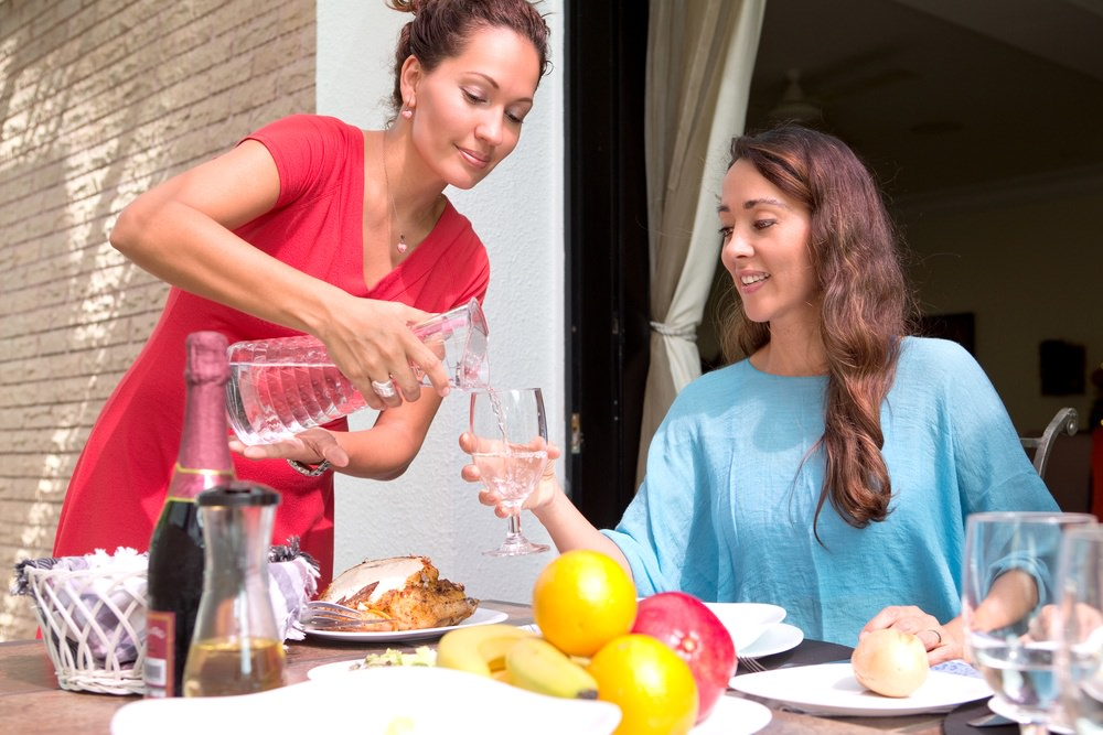 Women enjoy cleaner water and cost savings from home water softener system