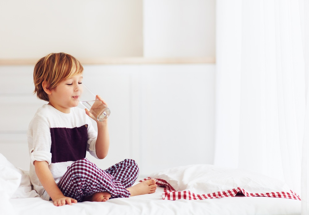 Child enjoys cleaner drinking water with whole home water filters