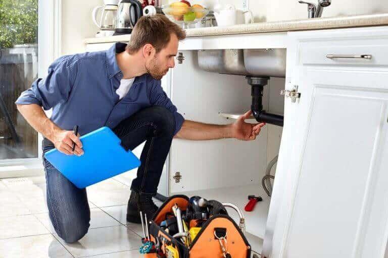 Technician installs water softener system
