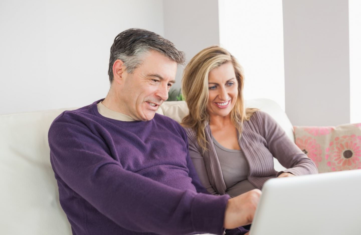 Man and woman read Water Softener System reviews