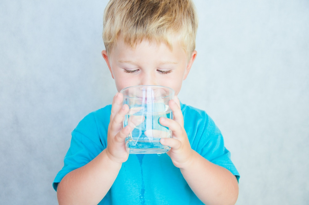 Child enjoys better tasting water from water softener system